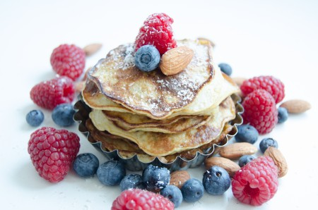 Banana pancakes with fruit, nuts and coconut