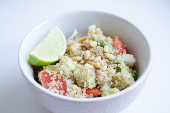 quinoa salad with avocado, tomatoes, pine nuts and lime juice