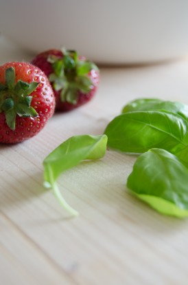 Strawberries and basil leaves
